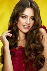 Fashion Makeup. Woman With Beauty Face And Long Curly Hair