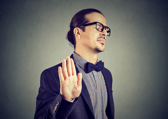 Offended man giving stopping gesture