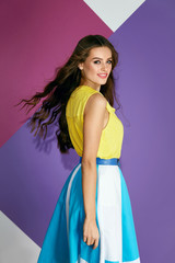 Fashion Clothes. Beautiful Woman In Colorful Dress In Summer