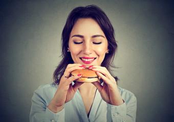 Young woman enjoying fast food