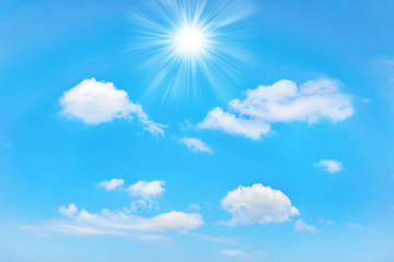 Beautiful blue sky with sunbeams and clouds. Sun rays