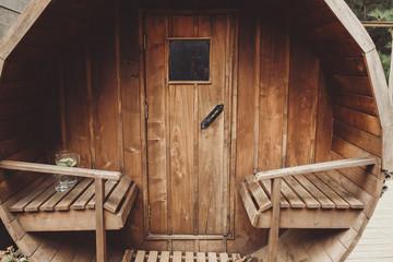 Beautiful wooden sauna outside a house