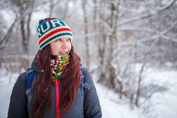 Portrait of woman with long hair in winter forest