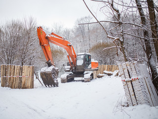 Photo of working excavator in winter day