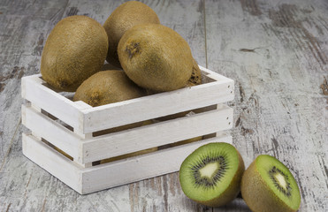 Juicy ripe kiwi fruit in wooden basket
