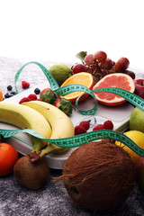 Healthy living or Diet concept. Fruits with measuring tape and a weight scale