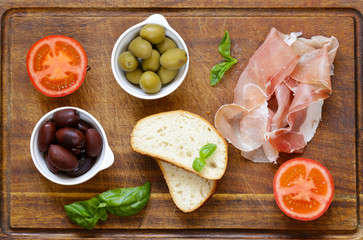 Parma ham, black and green olives - traditional food