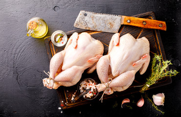 Whole Raw Chicken with Herbs and Spices on Wooden Cutting Board Food Ingredient Cooking Background Bird Meat