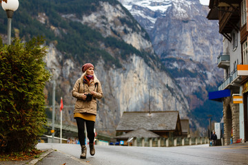 girl on a rural road in switzerland near the mountain jungfrau