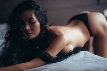 sexy asian woman perfect body on black lingerie in room
