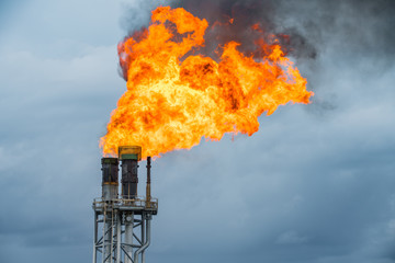 Fire on flare stack at oil and gas central processing platform while burning toxic and release over pressure from process.