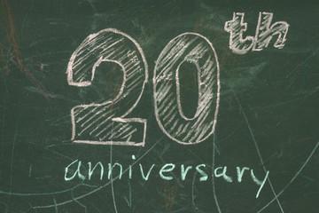 20 Year Anniversary logo on chalkboard written by color shocks.