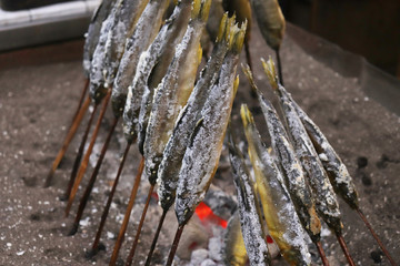 縁日や屋台でみられる日本の郷土料理、鮎の塩焼きの写真素材