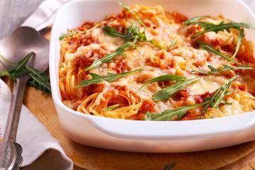 Spaghetti mozzarella bake with rocket,