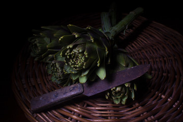 organic artichokes with old knife