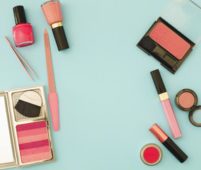 Beauty flat lay with woman make up products and accessories in pink color, top view