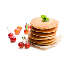 Stack  of scotch pancakes with fresh wild apples isolated on white