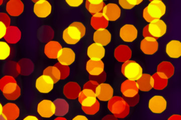 Colorful bokeh. The creative image of the bright lights. Blurred background.