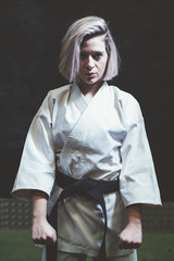 Woman who is exercised practicing karate