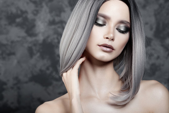 Young beautiful girl with silver make-up