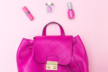 Female bright pink backpack on a pink background. Flat lay;
