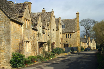 England, Cotswolds, Gloucestershire, a picturesque street scene in the village of Stanton