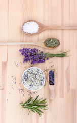 seasoned salt with herbs  / Top view of seasoned salt with rosemary and lavender blossoms  on a wooden background