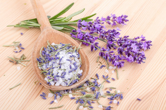 rosemary and lavender  / wooden spoon with Herb salt of rosemary and lavender blossoms