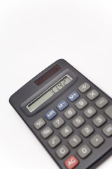 Calculator on white background showing value of pi, unsharp keyboard