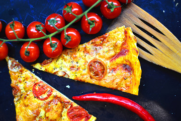 Food wallpaper with italian pizza portion on a baking tray.