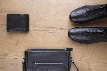 flat lay of black leather mens accessories