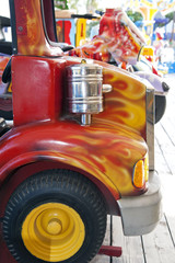 Detail of a toy lorry in the amusement park