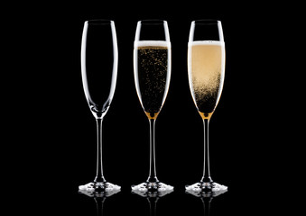 Elegant glasses of yellow champagne with bubbles