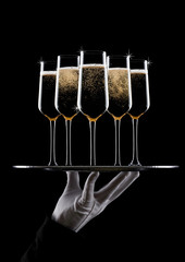 Hand with glove holds tray with champagne glasses