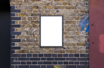 Blank advertising A2 poster billboard on brick wall
