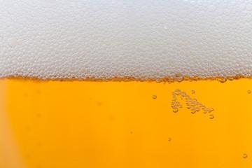 Jug of blonde beer with foam