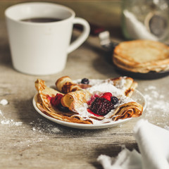 Pancakes with berries and sweet jam