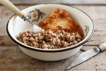 buckwheat porridge and a piece of meat