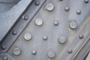Detail of old sea port crane frame. Steel painted background with rivets illustrating industry and construction concepts.
