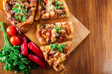 Sliced traditional Turkish pide with meat and vegetables