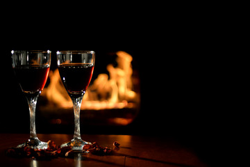 Romantic scene with wine Glasses and Fireplace