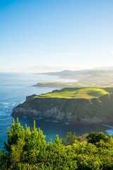 Spoed Fotobehang Blauw Beautiful nature view on Azores with small villages, tows, green nature fields. Amazing Azores.