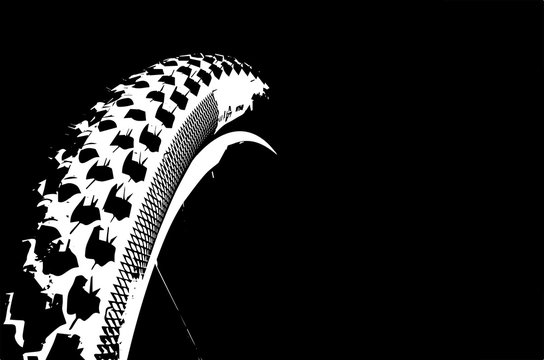 Cover the bicycle wheel. Moto concept on a black background. Graphical representation of the contour of a bicycle wheel