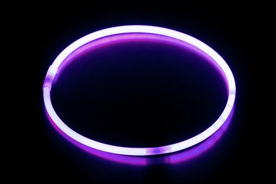 Round violet glow stick bracelet/ Round violet glow stick bracelet on a black surface with reflection