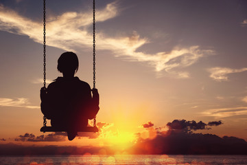 Freedom and carefree of a young female on a swing