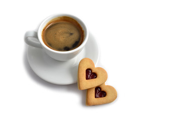 Cookie with coffee stock images. Cup of coffee on a white background. White cup of coffee with snack. Cup of coffee with cookie. Espresso with sweetness. Sweet biscuits hearts