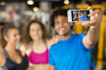 Group of friends taking a selfie while working out