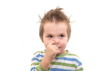 Handsome little boy picking his nose isolated on white background