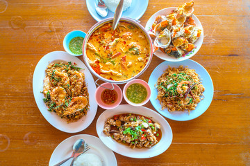 Tom Yum Koong, Steamed crab, Shrimp fried hot pepper with garlic, squid fried shrimp paste, group set of popular delicious favorite seafood of Thailand