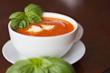 Creamy tomato soup with mozzarella and basil